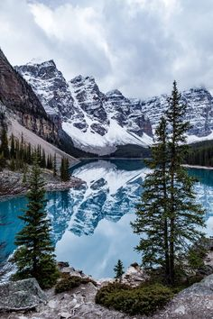 The stunning Moraine Lake in Banff National Park, Canada.  ✈✈✈ Here is your chance to win a Free International Roundtrip Ticket to anywhere in the world **GIVEAWAY** ✈✈✈ https://thedecisionmoment.com/free-roundtrip-tickets-giveaway/