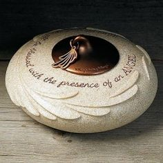 Our memorial stone-look memorial candle holder offers a unique way to ...