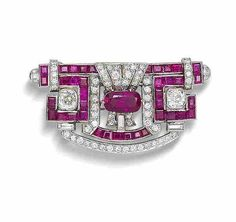 An art deco ruby and diamond plaque brooch, circa 1930 The central cushion-shaped mixed-cut ruby, weighing 2.18 carats, between two cushion-shaped diamonds, within a pierced scroll-shaped mount, symmetrically-set with calibré-cut rubies and brilliant, old brilliant, single and baguette-cut diamonds, diamonds approximately 3.15 carats total.