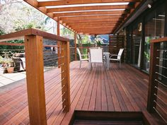 Wooden decking outdoor entertainment area. #Landscaping #Garden #Fusionlandscapes