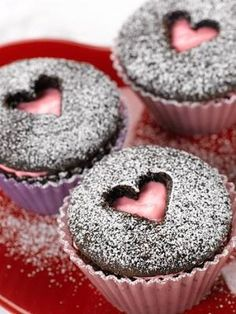 Slice off top of cupcake, frost underneath, then replace top with shape cut out in middle.  Sprinkle with powdered sugar by loretta