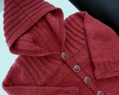 Hand knitted red baby hoodie about 3-6 months. by SnuggleBubs