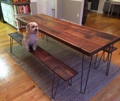 CustomMade by William Ney: This piece was designed for a client who was interested in a table using antique reclaimed wood, contrasted with modern hairpin legs. The tabletop and benches are composed of solid slow-growth white oak. The table is trimmed 1 1/4