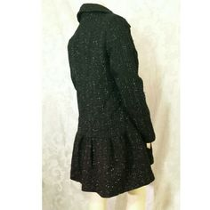 PRICE DROP! NWT B B DAKOTA BLACK COAT Size Large NEW B B Dakota black coat features snap button closure and bottom skirt design. Coat fabric is similar to a tweed coat with Silver threading material sewn throughout the tweed fabric. 38% Wool 62% polyester. B B Dakota Jackets & Coats