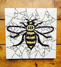 Inspired by the worker bee that has been the symbol of Manchester since the Industrial Revolution.  A hive of traditional bee mosaics and cotton flowers adorn the floors of the Great Hall in Manchester Town. Buttermilk background, black, white and yellow Each mosaic is hand crafted making every piece unique Dimensions 25cm x 25cmAll orders will be dispatched within 3 working days if your order is urgent please contact me and I'll do my best to get it to you quicker.I also ...