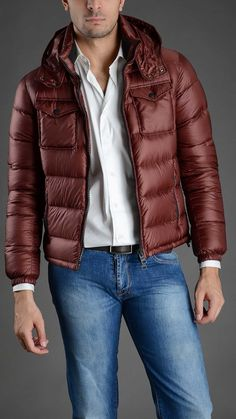Quilted down jacket with removable hood, four pockets, elasticated cuffs, zip fastening. 100% polyamide. #herno2013