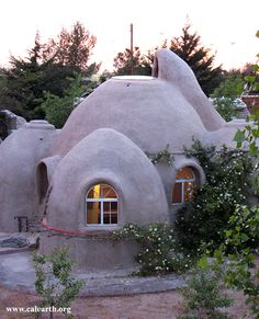 Superadobe Earth home.    Can't help thinking about the Smurfs when I saw this. However it is a great concept.