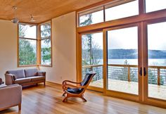 An interior view of Method Homes' modular house in Lake Whatcom, Washington that features Warmboard radiant heating.