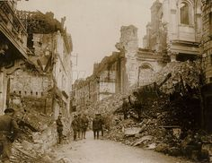 General Sir Samuel Hughes inspects the ruins brought about by German gunfire in the town of Arras, released 2 September 1916.  Official Canadian photograph.