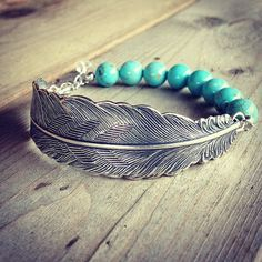 silver feather bracelet with turquoise magnesite gemstone beads and sterling silver chain