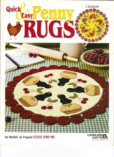 I've done two from this book, the cover and a santa pattern.  Pretty quick and cute penny rugs.