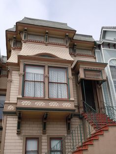 San Francisco stick / eastlake style house with squared bay-window Built ca 1886 panels of overlapping circle medallions, elongated brackets, and a hood of circular shingles on the bay are noteworthy on this stick style cottage - Olmstead / Here Today