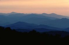 Layers of misty mountain ridges fade into the distant pink sunset. - Download High Resolution Image (tif) Orientation: Landscape Photographer/Submitter: John F. Mitchell Wilderness: Shenandoah Wilderness Categories: Sunrise/sunset Keywords: Sunset