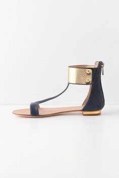 """Anthropologie Embraced Sandals     1 review Write a review  $168.00  Shown In: Blue     size guide  SizeShow  QuantityShowadd to bag  Add To Wish ListSend To Friend   DETAILS  The perfect match for chatty summer dresses, a metallic cuff brings this understated pair to a close. By Dolce Vita.  Fits true to size  Back zip  Leather, metal upper  Leather insole  Leather, synthetic sole  6""""H  Imported  you may also like         Printable Reviews"""