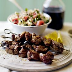 Marinated lamb skewers with giant couscous salad