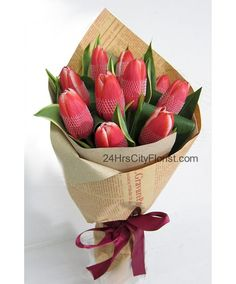 #tulips #kraftpaperbouquet #sgflorist  http://www.24hrscityflorist.com/tulip-sensation.html