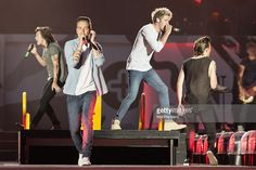 Harry Styles, Liam Payne, Niall Horan and Louis Tomlinson of One Direction perform on stage at Century Link Field on July 15, 2015 in Seattle, Washington.