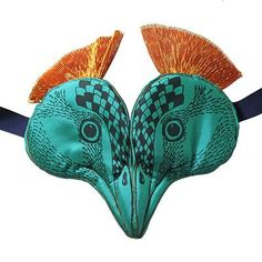 Screen-printed handmade turquoise padded cotton headdress with peacock illustration and ribbon tie fastening designed and created by Sara Lowes. A beautifully handmade...