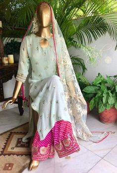Never loose an opportunity of seeing anything beautiful. Mint georgette kurta with mukaish work, teamed with hot pink leheria palazo and a net dupatta with thread and sequin work. There is tilla and zari hand work on the paucha. Indian Attire, Indian Ethnic Wear, Pakistani Outfits, Indian Outfits, Indian Dresses, Kurta Designs, Blouse Designs, Suits For Women, Clothes For Women