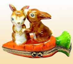 Bunnies couple Kissing on a Carrot Limoges Box
