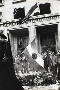 LEST WE FORGET Erich Lessing: Budapest, October © Erich Lessing/Magnum Photos The Hungarian Uprising- The Russian Communist emblem cut out of the Hungarian flag Hungarian Flag, Anno Domini, Forget, Magnum Photos, Second World, Budapest Hungary, Cold War, Old Pictures, Historical Photos