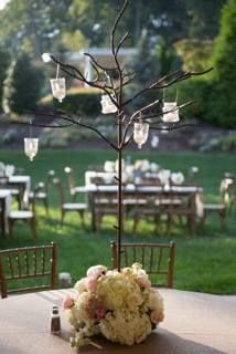 Iron tree with hanging votives and floral at base. Samuel Franklin Floral & Home