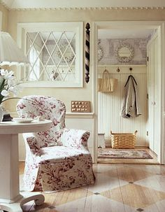 pretty mud room - love the painted floor