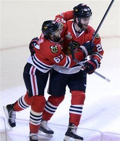 Chicago Blackhawks center Michael Frolik and left wing Brandon Saad celebrate the tying goal in regulation during Game 1 in the NHL Stanley Cup Final hockey series , Wednesday, June 12, 2013, in Chicago. The Blackhawks won 4-3. (AP Photo/Daily Herald, John Starks)