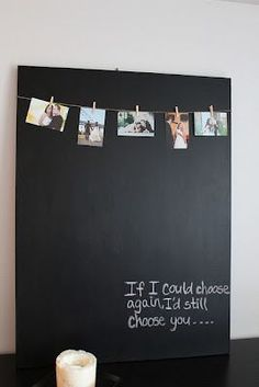 DIY canvas picture display  1.) take canvas and cover with chalkboard tape  2.) take string and hang clips on it  3.) hot glue to canvas  4.) hang pic on the clips
