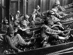 "Coal miners picking out ""impurities"" before the coal is processes. Before the child labor laws, much of this work was done by boys."