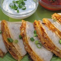 Texas Chicken Quesadillas | These are quesadillas filled with chicken cooked in barbeque sauce, caramelized onions, Cheddar and Monterey Jack.