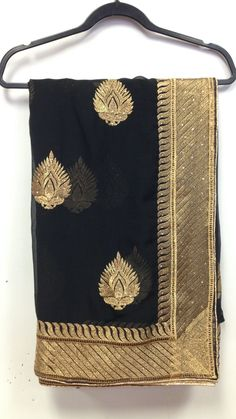 Chiffon party wear saree is crafted with heavy zari, resham embroidery border with stone work makes this indian apparel to die for. These party wear chiffon Saree features golden zari resham embroider