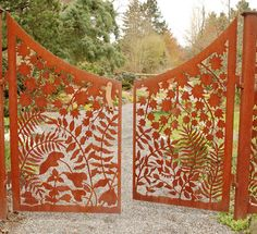 Garden gate with metal cutouts