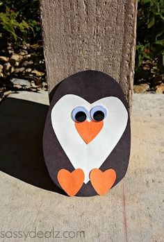 We decided to make an adorable heart shaped penguin today for our craft! This would be perfect for a Valentine's day craft or just for fun. It's very cheap and easy to make, my favorite :) You will need a piece of orange, black, and white construction paper. You'll also need a pair of big googly eyes, glue, and scissors.       Cut a black oval out for the body, one skinny white heart for the tummy, and three orange hearts. Two will be for the penguin's feet and one for the beak ...