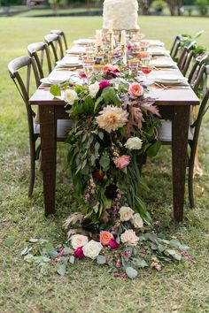 cascading floral runner - photo by J.Ashley Photography http://ruffledblog.com/wedding-elegance-at-bisham-manor