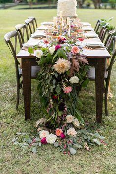 cascading floral runner - photo by J.Ashley Photography http://ruffledblog.com/wedding-elegance-at-bisham-manor #weddingreception #tablerunner #flowers