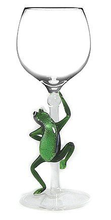 """Tree Frog Hand Made Wine Glass from Yurana Designs W259 by Yurana Designs. $35.00. This is not likely to be a gift they already have!. Approximately 8"""" Tall, and Holds about 6 Ounces. Great gift for Wine Lover. Hand Blown Wine Glass with Tree Frog into Stem. Hand Wash Only. Hand-blown Tree Frog Wine Glass by Yurana Designs W279. Hand Wash Only"""