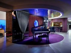 You can be a rock star when you check into the Hard Rock Hotel's Rock Star Suite in Punta Cuna, Dominican Republic. The room comes with its very own baby grand piano and translucent jellyfish tank. (Photo: Courtesy Hard Rock Hotel)