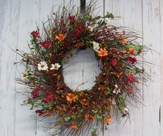 Fall is full of beautiful colors and so is this wreath! This Fall Daisy and pip berry wreath is a combination of burnt orange, mustard yellow and