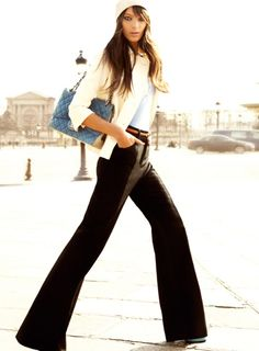 The Simply Luxurious Life®: Style Inspiration: Parisian Chic.  WIde leg black pants to the floor, white tee, colored belt.  Easy elegance. Work inspiration.