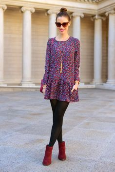 i hate dropwaists, but i love the idea of the dress, tights, ankle boots, and bun and the cute necklace too! #fall