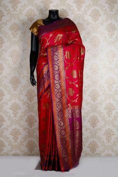 Rani pink multicoloured banarasi silk #zari weaved appealing saree with gold multicoloured border