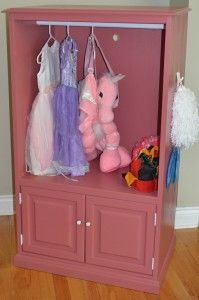 Solid oak TV unit turned into dress up station!  Great use of outdated but good quality furniture!