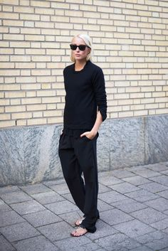 Ellen Claesson is wearing layers and all black. Cashmere top from Davida, shirt from Filippa K, trousers from Hunky Dory and sandals from At...