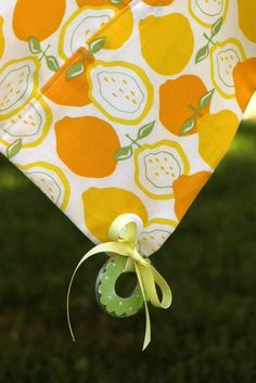 Heavy duty washers (spruced up with ModPodge and scrapbook paper) + ribbon = outdoor tablecloth weights