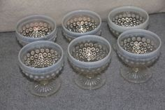 "Anchor Hocking Moonstone Opalescent Hobnail Low Sherbets or Custards, 3¼"" tall. $29.99/Set of 6 at allthisjunk4u on ebay, 2/24/16"