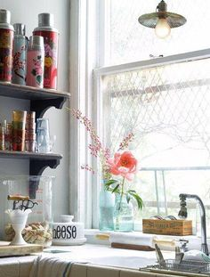 Kitchen: I love the collection of thermoses on the shelf!