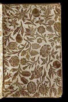 Papier dominoté sur les contreplats et les gardes volantes de : Almanach royal, année M.DCC.LI