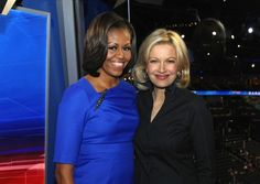 Mrs. O wore an Ann Taylor wool dress in a vibrant blue adorned with an Alexis Bittar elongated marquis pin.