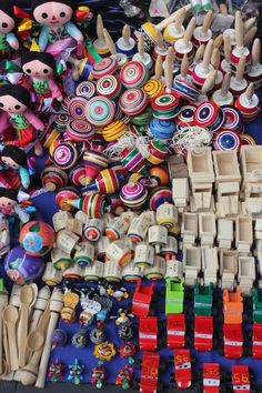 This colorful street display of toys is so characteristic of Mexico and the love of beauty. ✢ Viva la FIESTA | juguetes